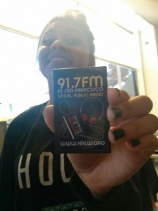 Noelia Gonzalez, a young engineer at Sunset Youth Services, shows off a magnet from one of her new favorite radio stations.